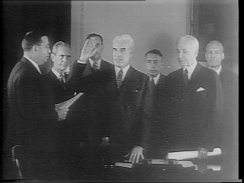 vídeos de stock, filmes e b-roll de sumner welles walks out of state building down stairway to awaiting car stops for closeup in camera / edward stettinius takes oath sworn in as new... - paramount building