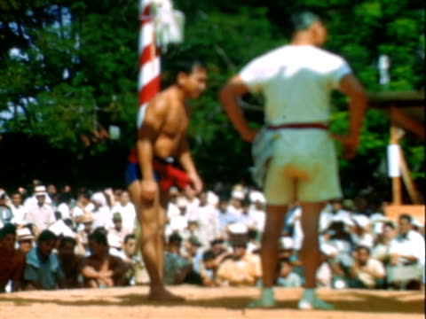 sumo wrestling from okinawa, japan / sumo wrestling outdoors / sumo wrestling ring / sumo wrestlers standing around / sumo wrestlers, young asian men... - 格闘技リング点の映像素材/bロール