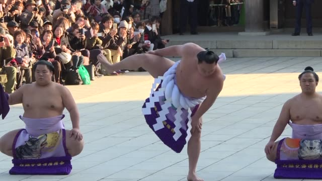 sumo's three grand champions clap their hands and stamp their feet in a traditional new year offering to the shinto gods as the sport tries to close... - shinto stock videos and b-roll footage