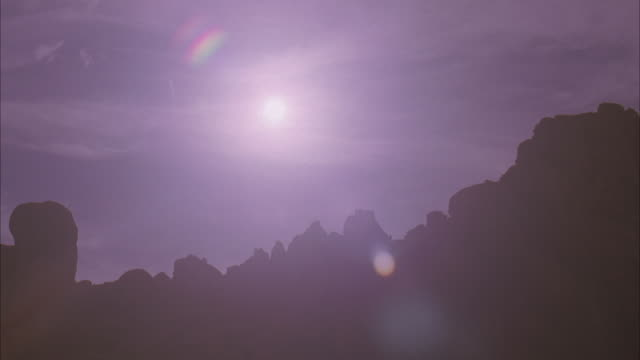 ws, sun above rocks / california - palm springs california stock videos & royalty-free footage