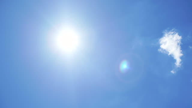 sun and flare on blue sky - solar flare stock videos & royalty-free footage