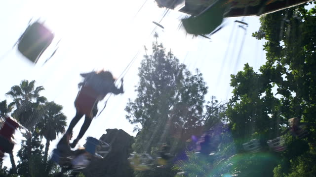 sun and giant swings at a fair - agricultural fair stock videos and b-roll footage