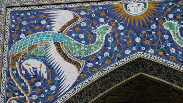 sun and phoenix artwork on nadir divan-begi - bukhara stock videos & royalty-free footage
