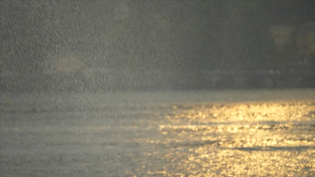 sun and rain raining on a stormy day on lake como, italy, europe. - slow motion - mediterranean culture stock videos & royalty-free footage