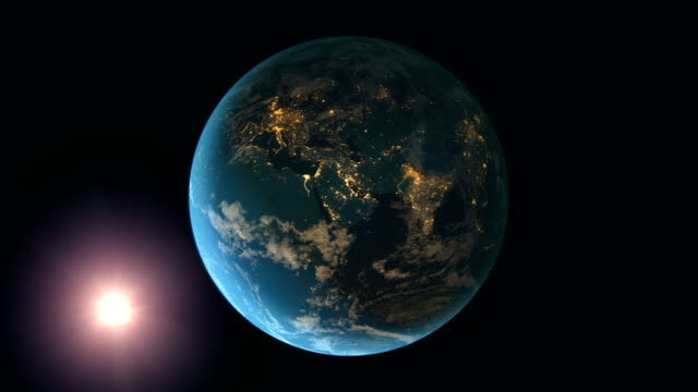 sun and rotating earth at night (europe view) - planet earth stock videos and b-roll footage