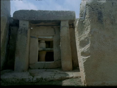 sun and shadows shift over ancient temple ruins mnajdra malta - temple building stock videos & royalty-free footage