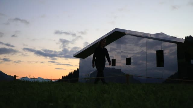 sun at dusk shine on mirage gstaad by los angelesbased artist doug aitken is on display outside as installation sculpture representing a chalet made... - kaleidoscope pattern stock videos & royalty-free footage