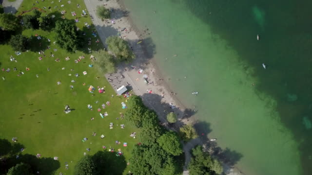 sun bathing and swimming at the beach in lucerne - lake lucerne stock videos & royalty-free footage