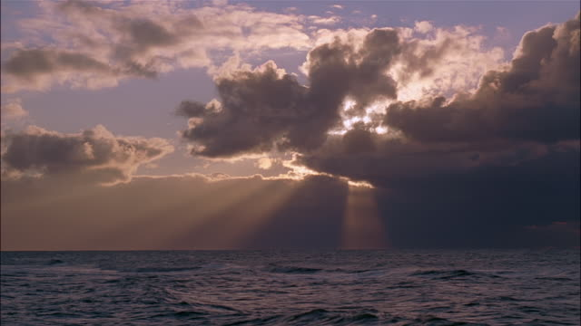 sun beams stream down from clouds above the sea. - sylt stock videos & royalty-free footage