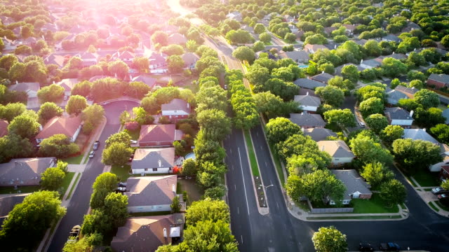sun burst sun beams modern spring time suburb homes - district stock videos & royalty-free footage