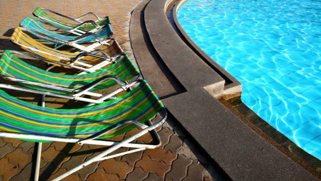 Sun chair near swimming pool
