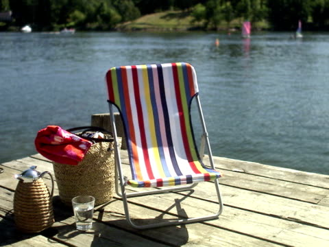 a sun chair on a jetty sweden. - jetty stock videos & royalty-free footage