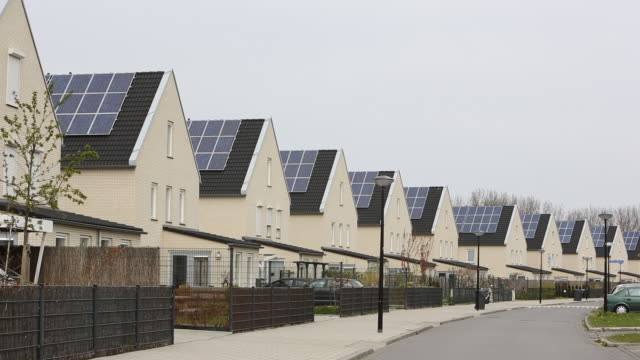 sun city a suberb of heerhugowaard in the netherlands that has develped as a solar hot spot, with the majority of the houses powered by solar panels and is the largest co2-neutral residential area in the world. - roof stock videos & royalty-free footage