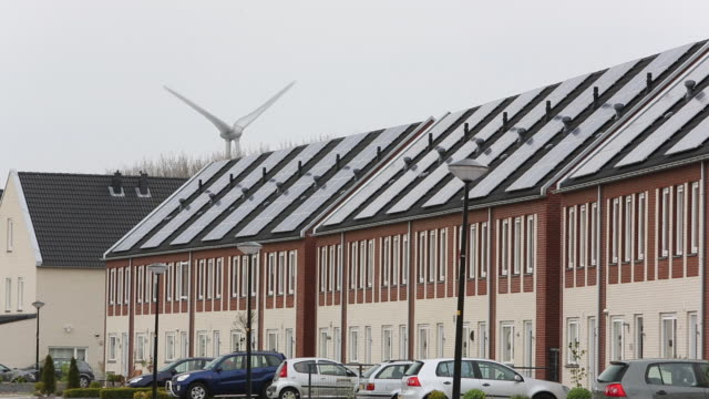 sun city a suberb of heerhugowaard in the netherlands that has develped as a solar hot spot, with the majority of the houses powered by solar panels and is the largest co2-neutral residential area in the world. - rooftop stock videos & royalty-free footage