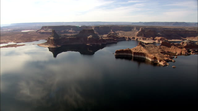 sun,  clouds and rock reflections in lake powell  - aerial view - utah,  kane county,  united states - lake powell stock videos & royalty-free footage