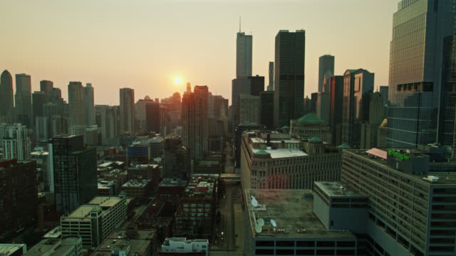 sun coming up over chicago - drone shot - willis tower stock videos & royalty-free footage