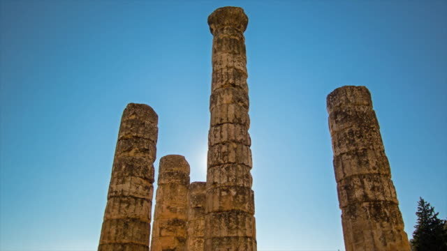 Sun crossing greek columns in Delphi. 4K Time lapse