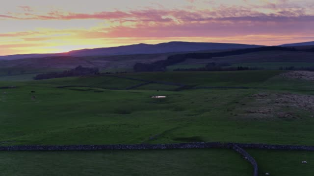 Sun Disappearing Behind Hills in Yorkshire Dales - Drone Shot