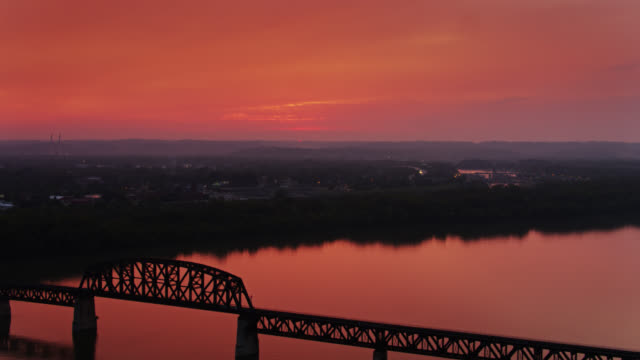 sun disappearing on the horizon at the falls of the ohio state park - drone shot - horizon over water stock videos & royalty-free footage