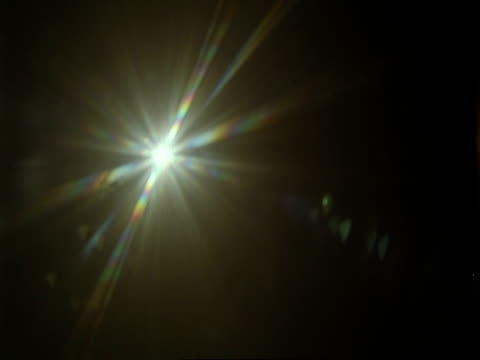 sun effect, looking up at midday sun - mezzogiorno video stock e b–roll