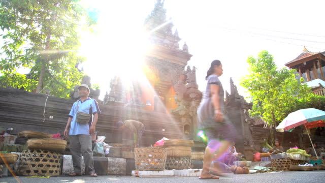 sun flare over asian street market in bali - indonesia video stock e b–roll