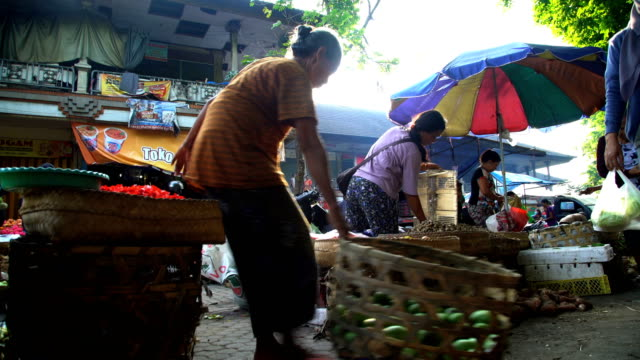 sun flare through people shopping street market indonesia - balinese culture stock videos & royalty-free footage