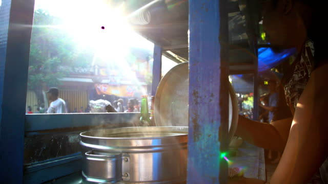 sun flare through street market food stall bali - street food stock videos & royalty-free footage