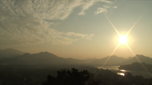 WS HA Sun Flaring Over River Valley / Pak Ou Villages, Laos