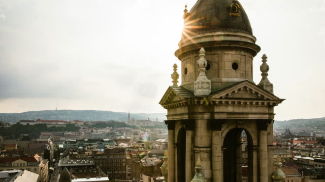 sun going down behind a church spire in budapest - hungary stock videos & royalty-free footage
