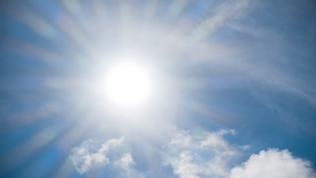 sun in blue sky time lapse - midday stock videos & royalty-free footage