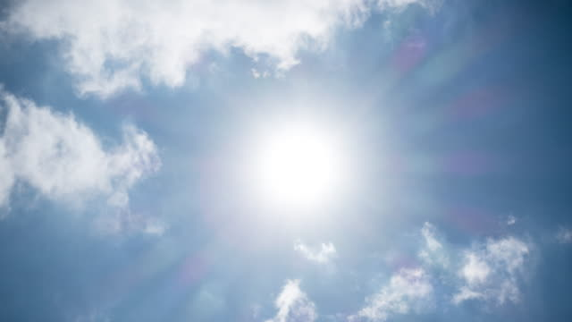 sun in blue sky time lapse - summer heat stock videos & royalty-free footage