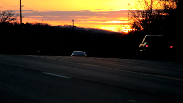 sun is almost set at rush hour - saturated color stock videos and b-roll footage