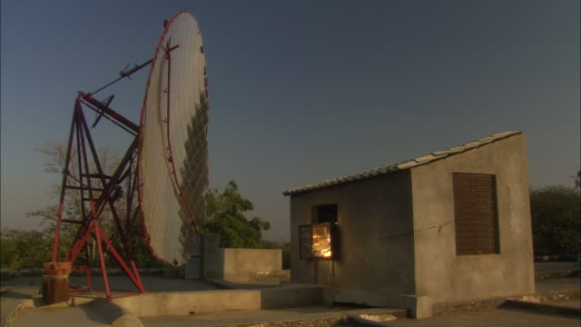sun is reflected with large dish for make-shift solar powered cooking rajasthan india available in hd. - makeshift stock videos and b-roll footage
