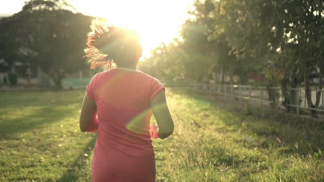 sun light back side woman running