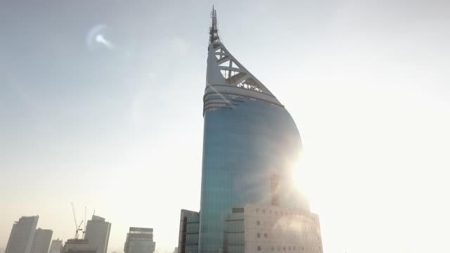 sun lights bni 46 tower of jakarta - jakarta stock videos & royalty-free footage