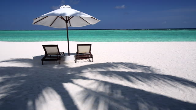 Sun lounger on beach in Maldives, Indian Ocean