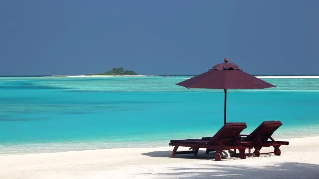 sun loungers and tropical beach, maldives, asia - beach chairs stock videos & royalty-free footage