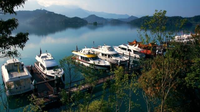sun moon lake in shuishe pier at dawn, taiwan - sun moon lake stock videos and b-roll footage