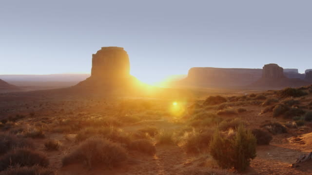 sun on horizon at monument valley - monument valley stock videos & royalty-free footage