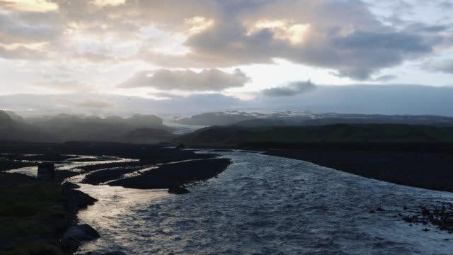 Sun over Icelandic wetland. River pool