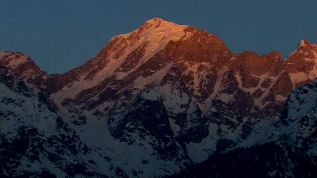 Sun passing over himalayas mountain range in Kinnaur India