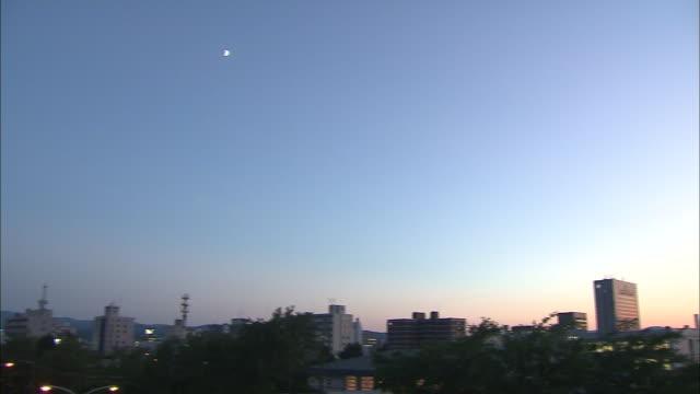 a sun pillar glows over the hills near asahikawa city center. - asahikawa stock videos & royalty-free footage