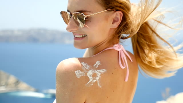 sun protection & joy at pool - uv protection stock videos and b-roll footage