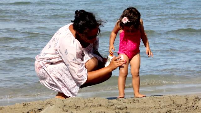 sun protection (hd) - sun cream stock videos and b-roll footage