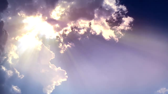 sun ray from the edge of cloud - sunbeam stock videos and b-roll footage