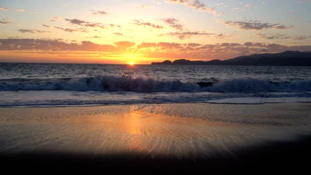 Sun Rays beam out Sunset on Baker's Beach in San Francisco , California