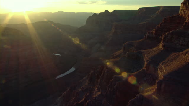 sun rays extend from the horizon to the cliffs of the grand canyon. - grand canyon stock videos & royalty-free footage