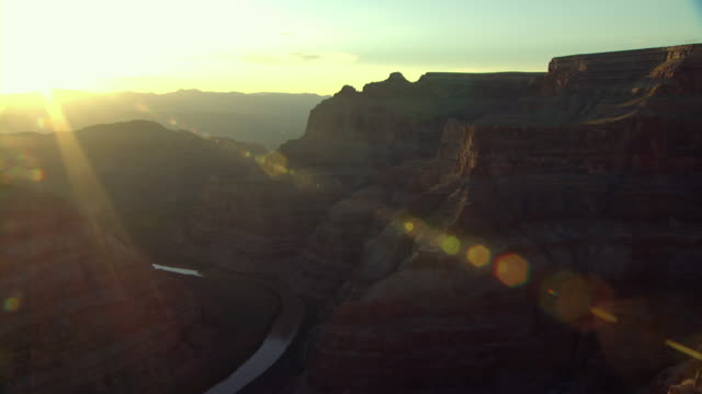 sun rays extend from the horizon to the cliffs of the grand canyon. - grand canyon stock videos and b-roll footage