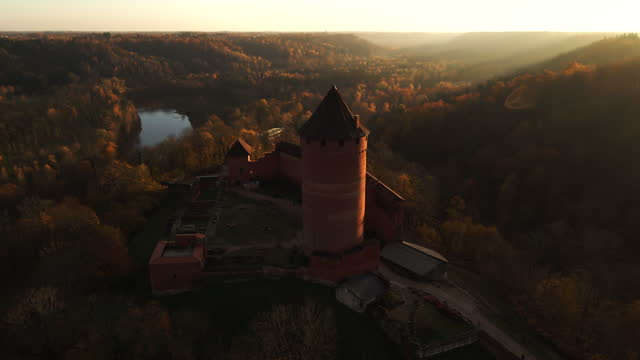 sun rays fall onto turaida castle during sunset aerial view - castle stock videos & royalty-free footage