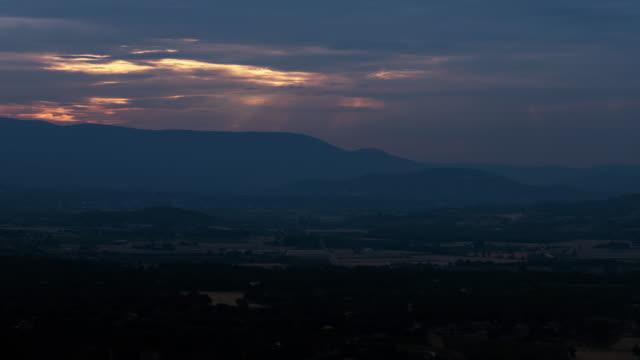 vidéos et rushes de sun rays passing by dark clouds - frolow